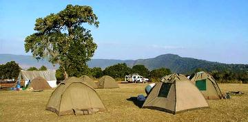 If you really want to enjoy the great outdoors, why not stay in it. Bring your tent!