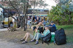 To travel long term could mean waiting for a bus in Byron Bay, Australia...