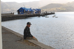 "Aron in the ""French"" part of New Zealand – the cute little town Akaroa"