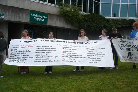 The girls with friends participating as volunteers at the Children's Book Festival, Nanaimo, Canada