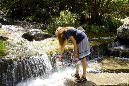 Aurora collecting drinking water at our favorite spring in the mountains above Marbella, southern Spain